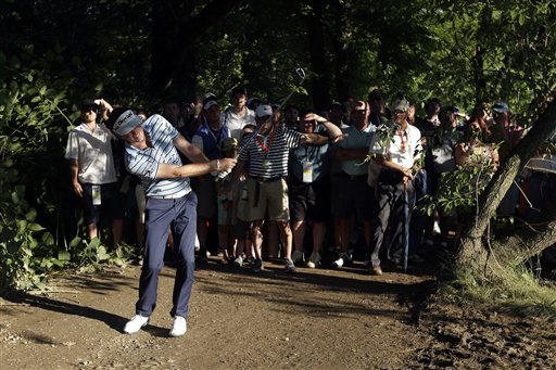 Keegan Bradley hits from a muddy path on the 12th hole during the second round of the U.S. Open golf tournament at Merion Golf Club in Ardmore, Pa., on Friday.