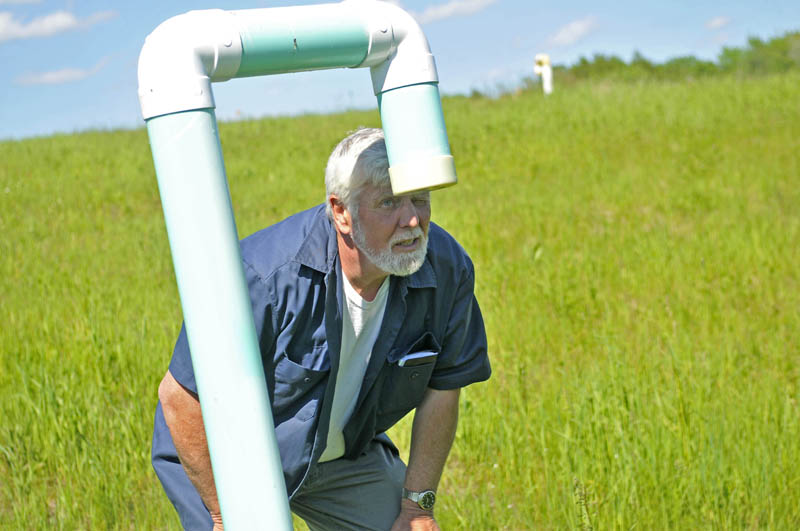 Johnny Thomas inspects a methane vent pipe on top of the dump at the Oakland transfer station on Wednesday.
