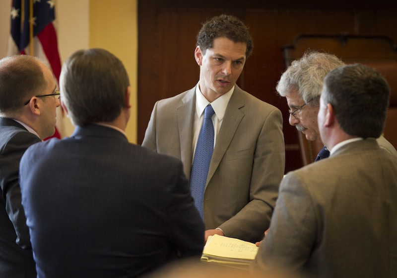 Senate President Justin Alfond, D-Portland, center speaks with Roger Sen. Katz, R-Augusta, right, and other senators during a session Thursday, June 13, 2013, at the State House in Augusta, Maine. Maine legislators return Wednesday to the State House, where observers expect them to override Gov. Paul LePage's veto of the proposed two-year, $6.3 billion state budget. (AP Photo/Robert F. Bukaty)