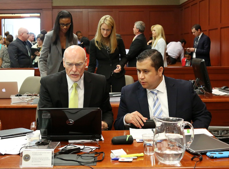 George Zimmerman, right, talks to attorney Don West during his trial in Seminole circuit court in Sanford, Fla. Wednesday, June 26, 2013. Zimmerman has been charged with second-degree murder for the 2012 shooting death of Trayvon Martin. (AP Photo/Orlando Sentinel, Jacob Langston, Pool)