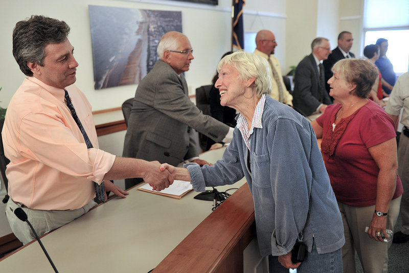 Newly elected Old Orchard Beach town council members were sworn in Monday, June 17, 2013. In this photo, OOB resident Elizabeth Mills greets newly elected council member Kenneth Blow following the meeting.