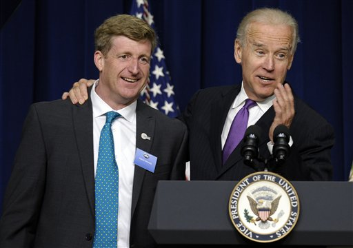 Vice President Joe Biden stands with former Rhode Island Rep. Patrick Kennedy as he speaks at the closing of the National Conference on Mental Health on June 3, 2013, in Washington.