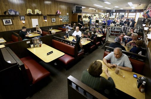 """A reserved sign sits on the booth where the last show of the HBO series """"The Sopranos"""" was filmed at Holsten's ice cream parlor in Bloomfield, N.J."""