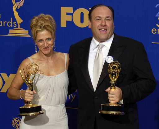 """In this Sept. 21, 2003, photo, Edie Falco and James Gandolfini hold the awards they won for outstanding lead actress and actor in a drama series for their work on """"The Sopranos"""" at the 55th Annual Primetime Emmy Awards in Los Angeles."""