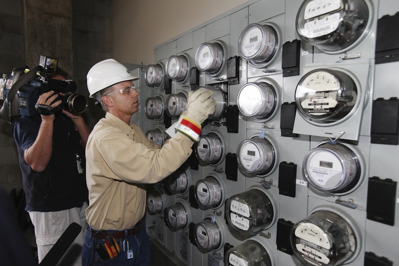 In this Sept. 28, 2010 file photo, Central Maine Power technician Gary Sturgis installs one of the company's first