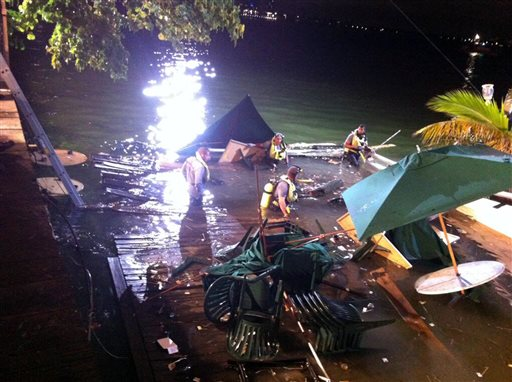 In this photo provided by WSVN-TV, divers search the water after a deck collapse at Shuckers Bar & Grill in Miami Thursday night. The deck collapsed during the NBA Finals on Thursday night, sending dozens of patrons into the shallow waters of Biscayne Bay.