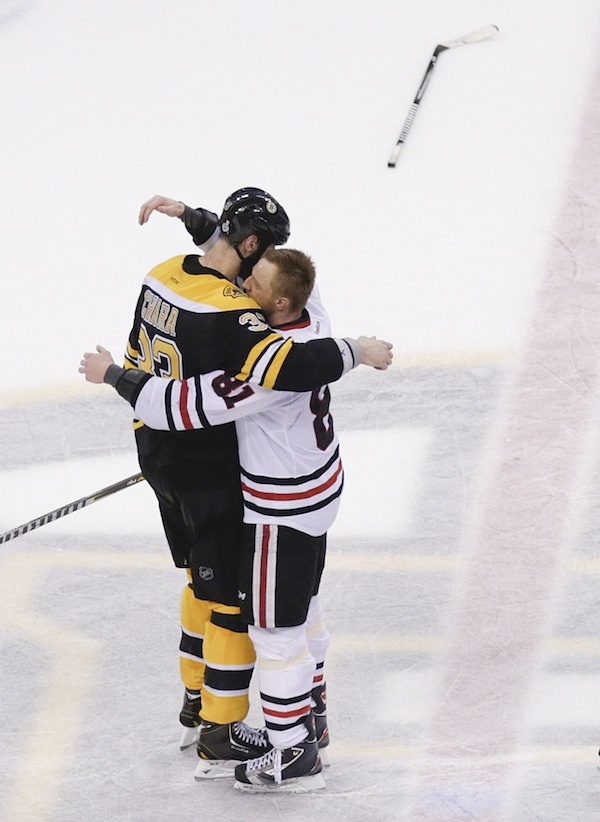 Boston Bruins defenseman Zdeno Chara (33), hugs Chicago Blackhawks right wing Marian Hossa (81), both of Slovakia, after the Blackhawks beat the Bruins 3-2 in Game 6 of the NHL hockey Stanley Cup Finals, Monday, June 24, 2013, in Boston. (AP Photo/Charles Krupa) TD Garden