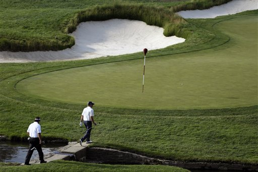 Phil Mickelson, left, and Steve Stricker walk to the ninth green Friday.