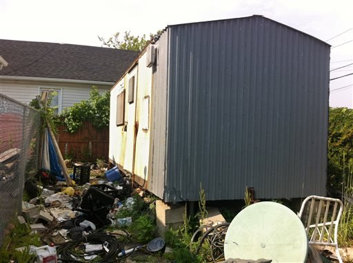 A dilapidated trailer sits up on blocks in a trash strewn lot in the Queens borough of New York recently. More than five month after Superstorm Sandy, the partially skeletonized remains of 62-year-old Keith Lancaster were found inside on April 5, 2013.