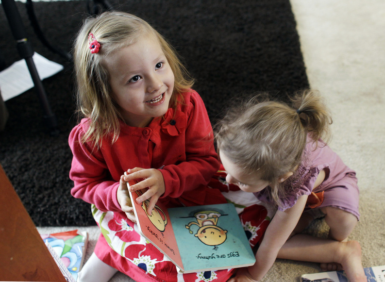 Coy Mathis, left, plays with her sister Auri at their home in Fountain, Colo., in February. Coy has been diagnosed with Gender Identity Disorder. Biologically, Coy, 6, is a boy, but to her family members and the world, Coy is a transgender girl.