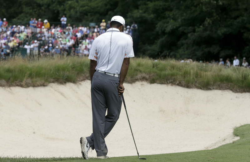 Tiger Woods reacts after a shot on the eighth hole during the second round of the U.S. Open golf tournament at Merion Golf Club on Friday in Ardmore, Pa.
