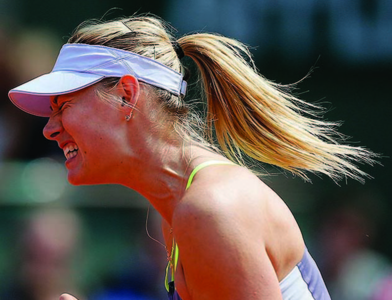 Maria Sharapova reacts shortly before defeating China's Jie Zheng during their third-round match Saturday at the French Open.