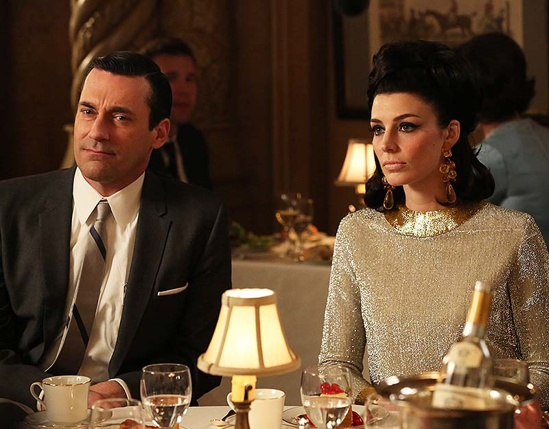 "This TV publicity image released by AMC shows Jon Hamm as Don Draper, left, and Jessica Pare as Megan Draper in a scene from ""Mad Men."" The season finale airs Sunday night. Linda Cardellini;Jon Hamm;Group"