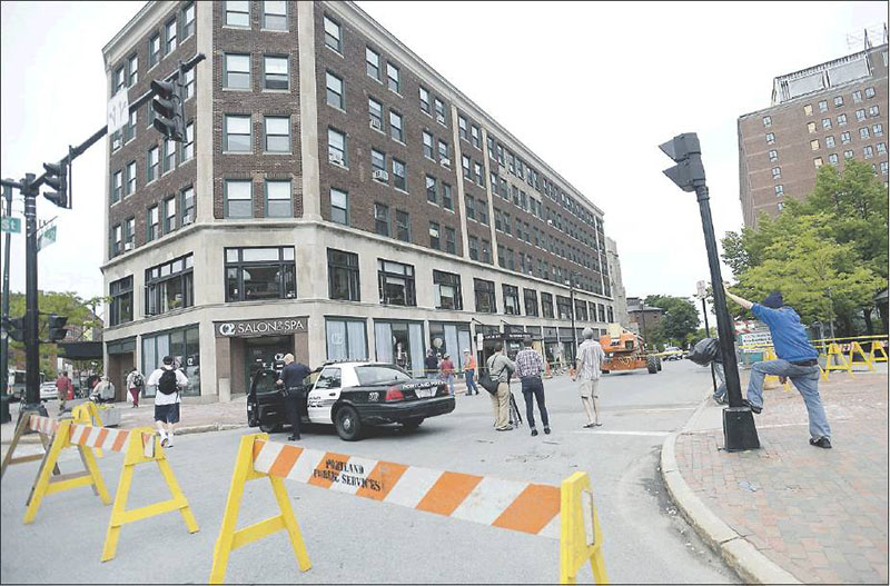 High Street between Congress and Deering streets in Portland is shut down Monday because of the buckling brick facade of the Congress Building. By evening offcials had opened one lane to traffc.