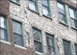 A large patch of bare wall is exposed on the Congress Building at 142 High St. on Monday.