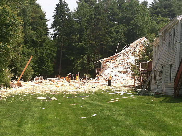An apparent propane blast that could be felt for miles killed one man, damaged homes and showers debris on a stunned neighborhood in Yarmouth on Tuesday.