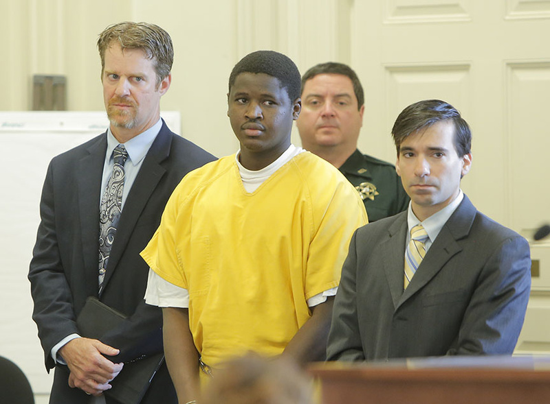 Bub Peter Nguany pleaded not guilty in York County Superior Court in Alfred on Friday to murdering Charles Raybine in Biddeford in this March 26, 2013 file photo. He is flanked by his lawyers Rick Winling, left and Luke Rioux.