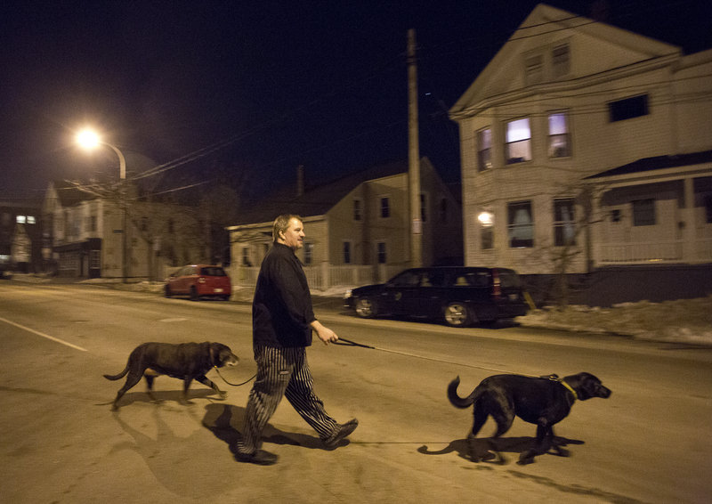 Near the end of a long day, Smith walks his dogs across Congress Street before heading back downtown to check in on the two restaurants he owns on Exchange Street.
