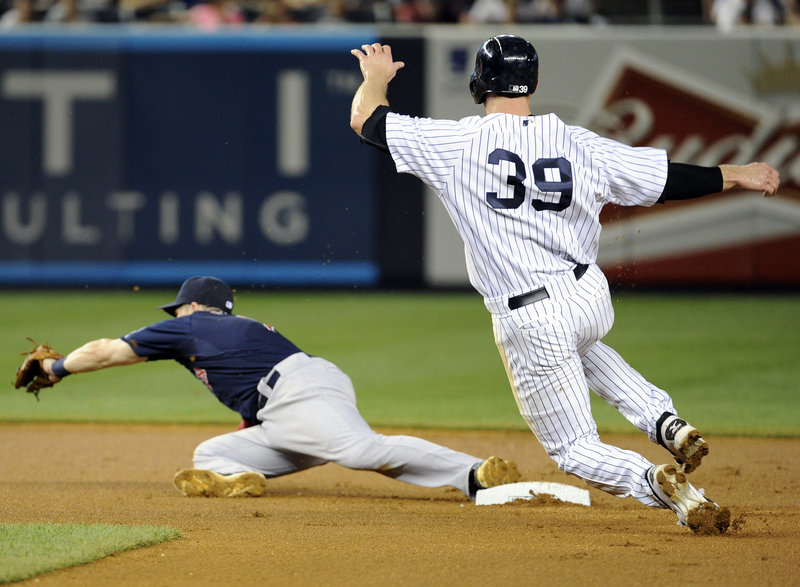 David Adams of the New York Yankees is out at second base Friday night as Red Sox shortstop Stephen Drew takes a throw in the fifth inning. Yankees Manager Joe Girardi was ejected while arguing the call.