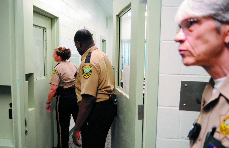 Kennebec County Corrections Facility officers check a cell block Wednesday in Augusta.