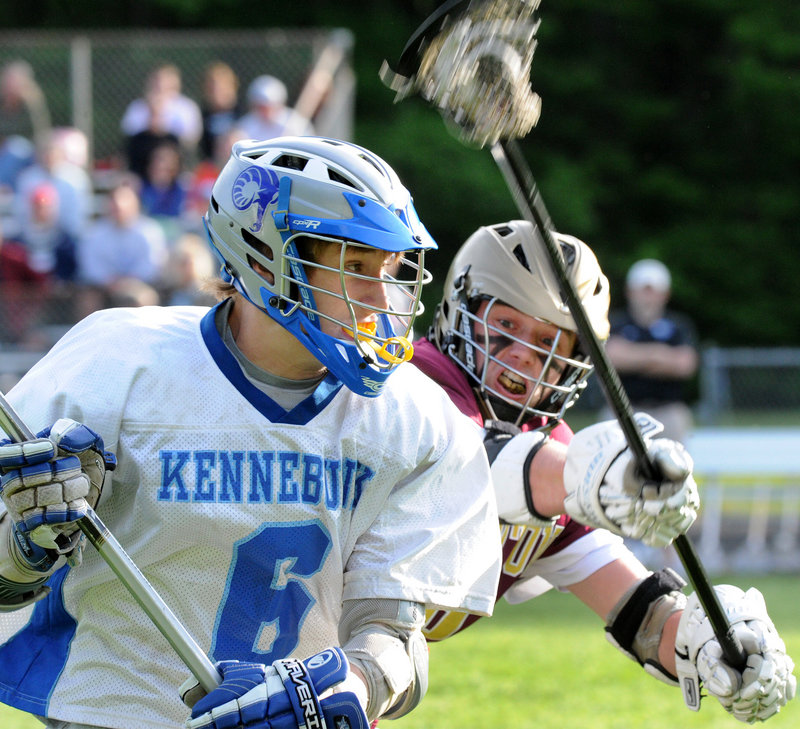 Ryan Keefe is defended by Thornton Academy's Daniel Giroux during Kennebunk's 12-8 win Wednesday in a Western Class A quarterfinal.