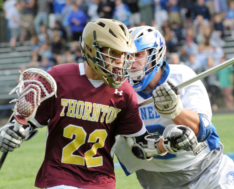 Photos by John Patriquin/Staff Photographer Christian Michaud of Thornton Academy tries to dodge Kennebunk's Nicco DeLorenzo during their Western Class A lacrosse quarterfinal Wednesday. Kennebunk won 12-8.
