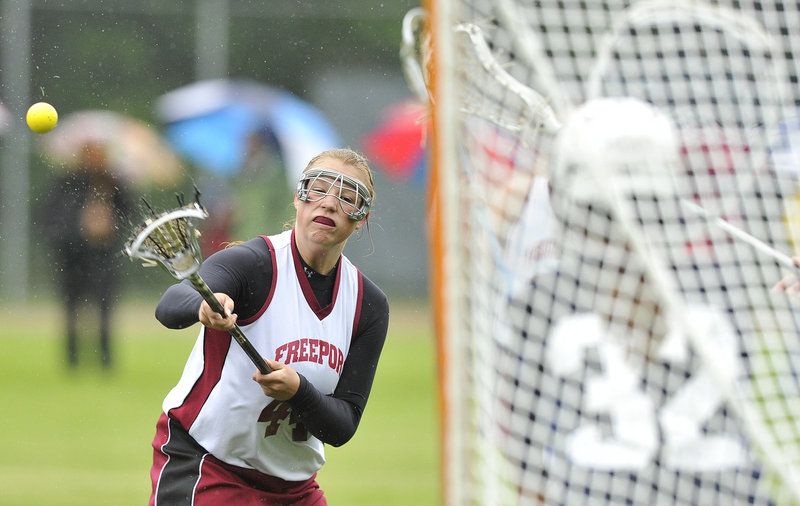 Dayze Gaulin of Freeport unloads a shot on goal during Yarmouth's 12-10 victory. Yarmouth will be home against Morse in the regional championship game Wednesday.