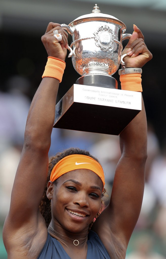 Serena Williams celebrates her victory in the French Open on Saturday, telling an appreciative crowd she considers herself a Parisian.