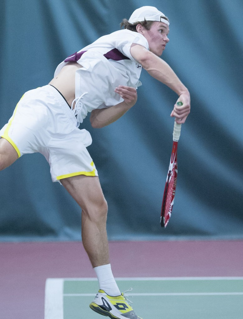 Matt Gilman of Cape Elizabeth serves in the No. 1 singles match at Saturday's Class B Championships in Bangor. Cape won, 5-0.