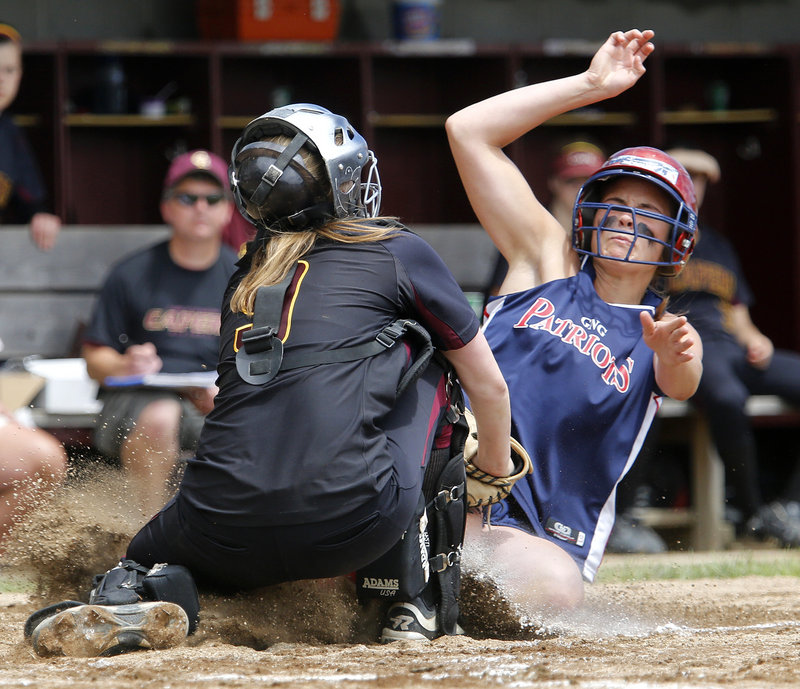 Cape Elizabeth catcher Elise Fathers holds her ground and tags out Maria Valente of Gray-New Gloucester. Gray-NG will play Greely for the Western Class B title.