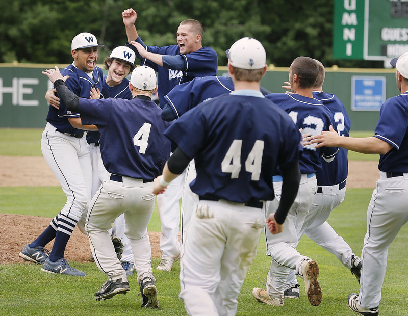 Keenen Lowe, left, is swarmed by his Westbrook teammates after completing a four-hit shutout Wednesday in a 5-0 win over Marshwood for the Western Class A title.