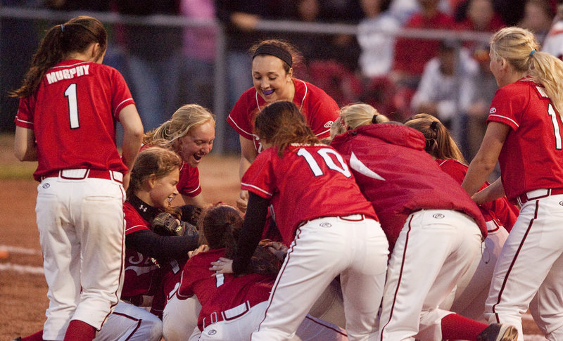 Scarborough players celebrate what has become an every-other-year occurrence – a Western Class A softball championship and a trip to the state final – after they bean Sanford 5-2 Wednesday night at St. Joseph's College.
