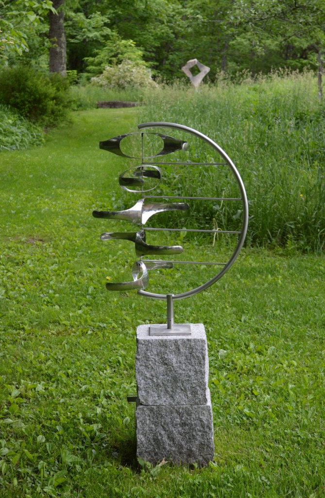 """Five Gyres in C,"" stainless steel by George Sherwood, from ""Sculpture for the Home and Gardens,"" the exhibition continuing through June 30 at June LaCombe Sculpture, Hawk Ridge Farm, Pownal."
