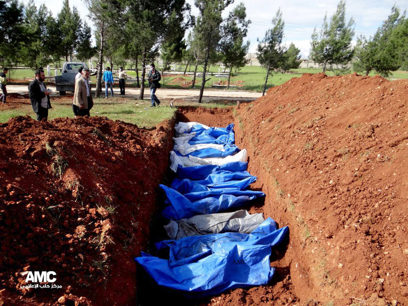 A mass burial of people allegedly killed by Syrian Army snipers in Aleppo, Syria, is shown in this authenticated citizen journalism photo from Aleppo Media Center.