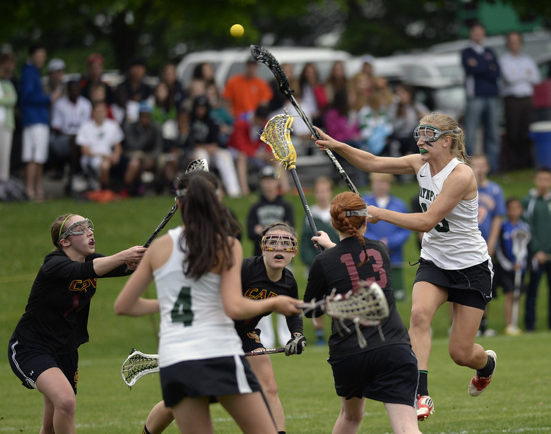 Martha Veroneau of Waynflete finds room to shoot Thursday between a group of Cape Elizabeth defenders. It was a familiar sight: Veroneau scored 10 goals as the Flyers captured the Western Class B girls' lacrosse championship with a 16-9 victory.
