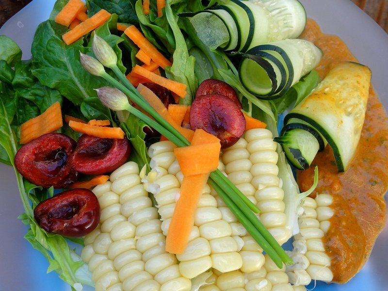 Green salad with corn, peppers and smoky red pepper dressing