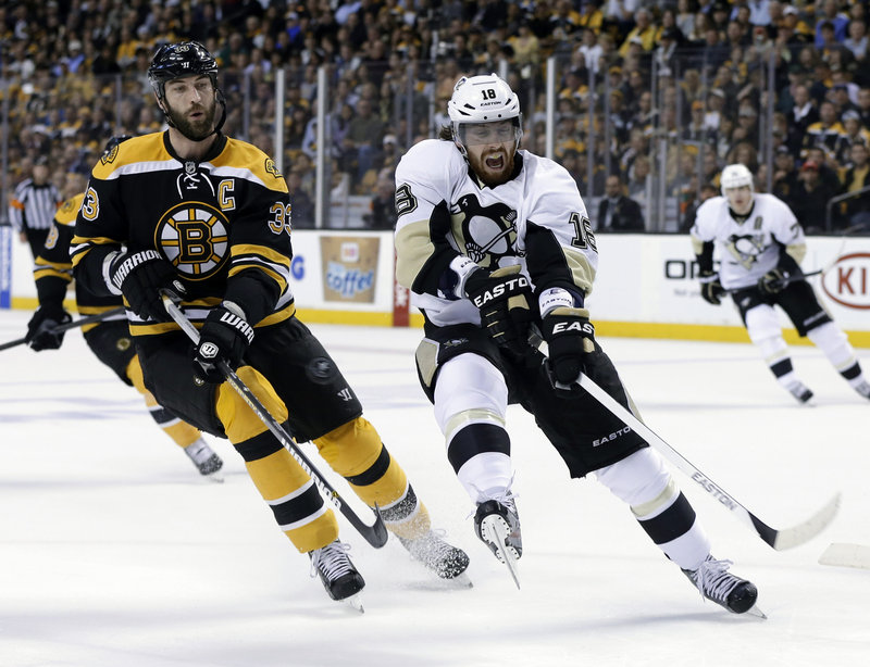 Zdeno Chara, shown matching Pittsburgh's James Neal stride for stride, might be the NHL's most physically intimidating defenseman, standing 6-foot-9.