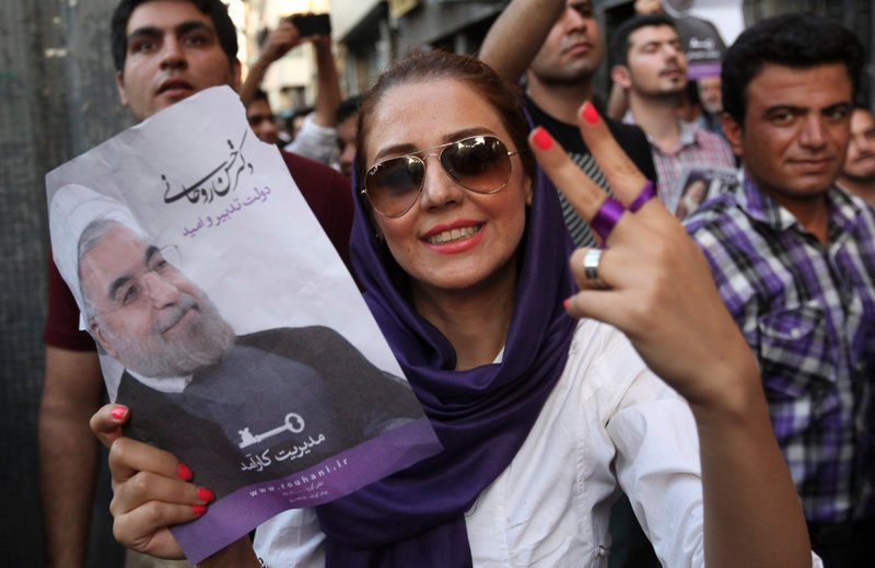 A supporter of Iranian presidential candidate Hasan Rowhani flashes a victory sign Saturday in Tehran.