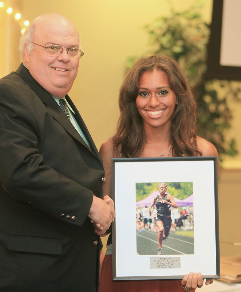 Brewer's Teal Jackson, with sports writer Paul Betit, was chosen as the top athlete for girls' outdoor track after winning four individual events at the Class A state meet.