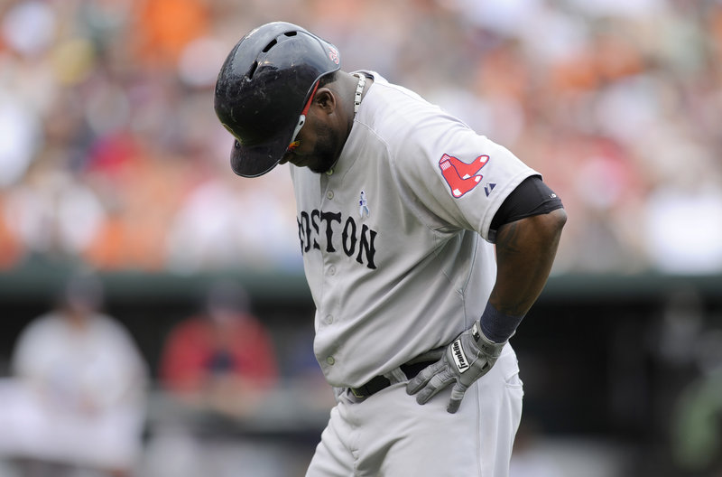 Red Sox designated hitter David Ortiz hangs his head after lining out to right field in the eighth inning of Boston's 6-3 loss to the Orioles at Baltimore on Sunday. Ortiz was 0 for 4.