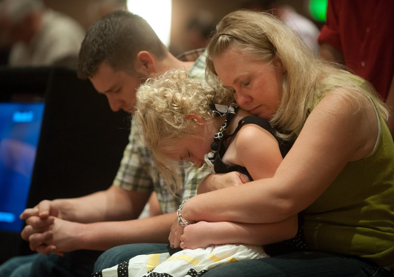 Lara Stern, right, prays with her daughter, Alana, 8, and her husband, Samuel, on Sunday after they lost their home to the Black Forest fire.