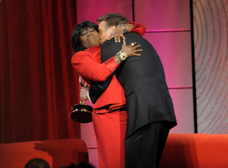 "Sheryl Underwood hugs Doug Davidson, winner of the award for outstanding lead actor in a drama series for ""The Young and the Restless."""
