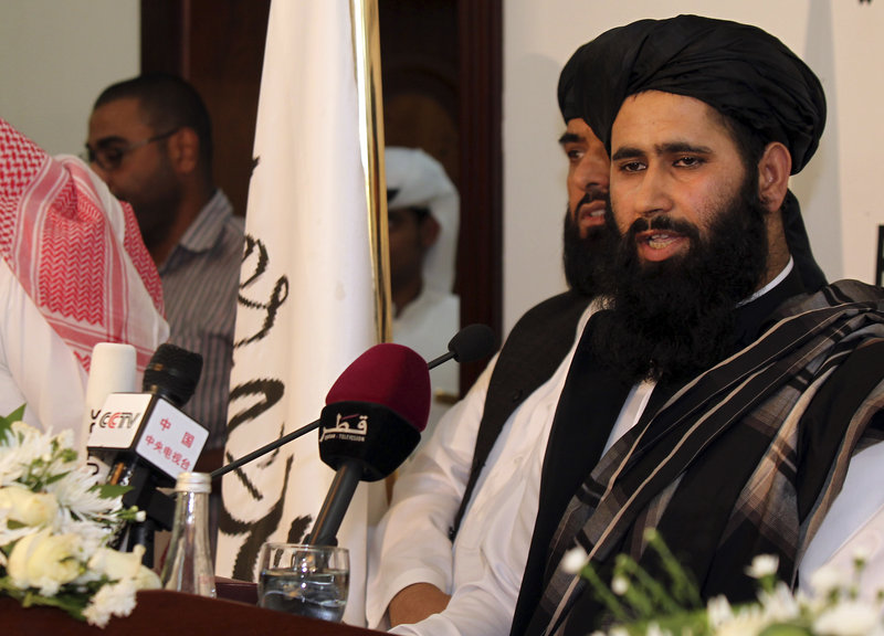 Muhammad Naim, a Taliban spokesman, speaks Tuesday at the Islamic militant movement's new office in Doha, Qatar. U.S. and Taliban representatives are expected to meet soon.