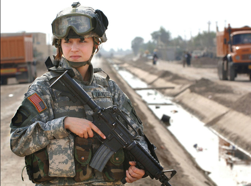 Pfc. Janelle Zalkovsky provides security while other soldiers survey a newly constructed road in Ibriam Jaffes, Iraq in this handout photo released December 7, 2005. Women will have more frontline jobs available to them under new Pentagon regulations.