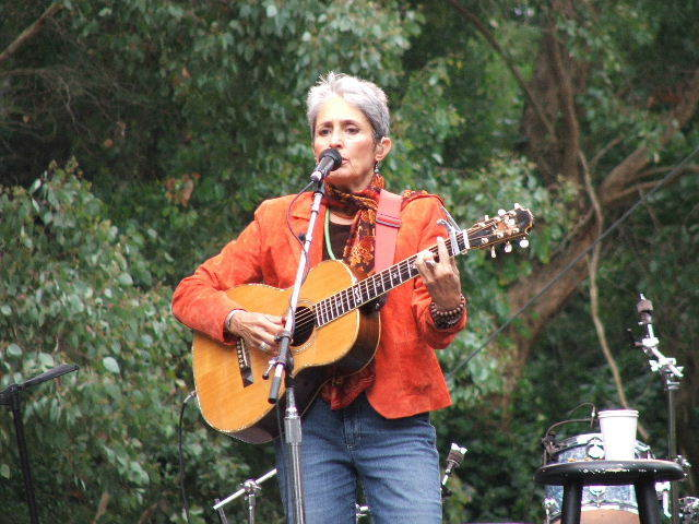 Joan Baez performs in San Francisco in 2005. Below, the artist in an undated photo.