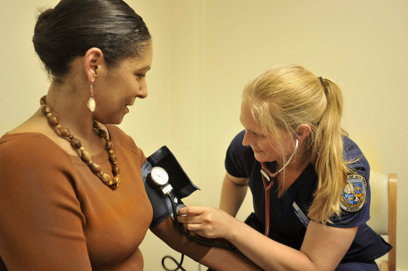 The Portland Community Health Center in Portland's Riverton Park, operated by the University of New England, will serve the immigrant, low-income and refugee communities. UNE student nurse Abby Pierce does a blood pressure check for Jessica Loney, of Bath, who attended the clinic's open house on Thursday, June 20, 2013.