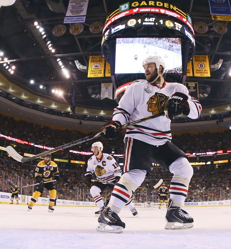 Chicago defenseman Brent Seabrook took Jonathan Toews (19) under his wing and the star forward responded with his first goal in 11 games in Wednesday's win at Boston.
