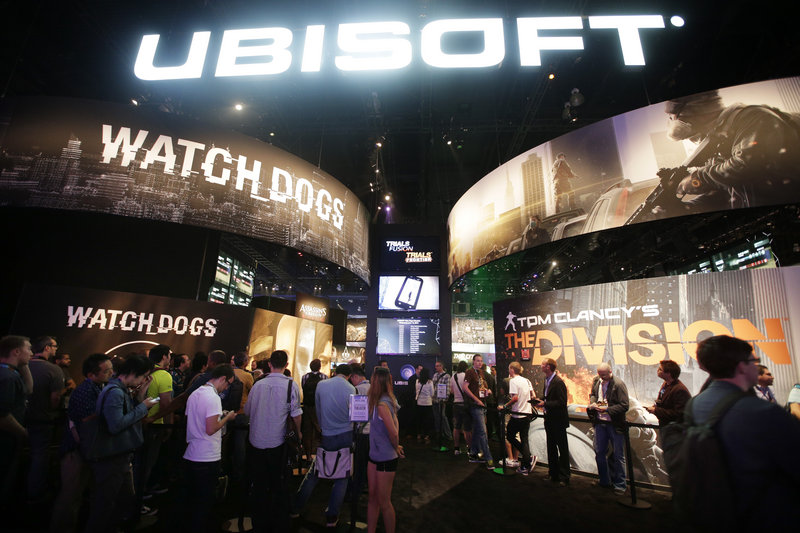 Attendees wait in line for presentations on two new video games,