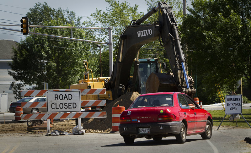 A motorist drives near Dustan Corner on Friday, June 21, 2103. Work on the new Payne Road-Route 1 intersection will switch to nighttime hours because the work has snarled traffic along busy Route 1 in the past week.
