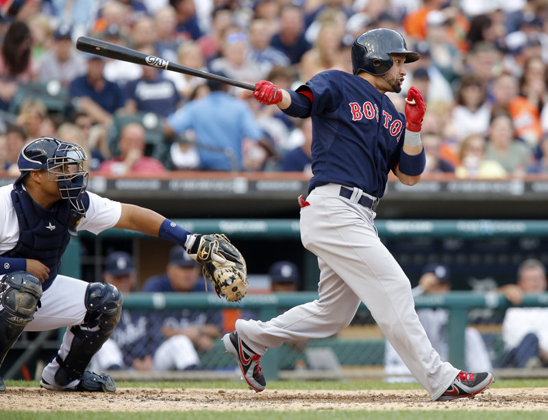 Shane Victorino follows through on a two-run single in the fourth inning Friday night, part of his five-RBI game that helped the Boston Red Sox provide Jon Lester with a victory, downing the Detroit Tigers, 10-6.
